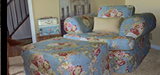 blue floral slipcovered chair and ottoman