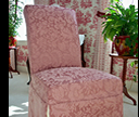 pink slipcovered chair