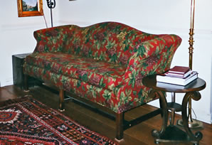 red floral slipcovered sofa